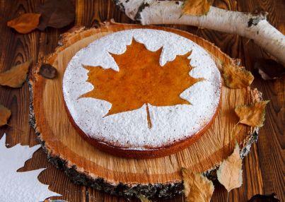 homemade-tasty-manna-with-a-sugar-powder-stencil-of-a-maple-leaf-on-birch-saw-cut-1200x853