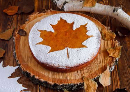homemade-tasty-manna-with-a-sugar-powder-stencil-of-a-maple-leaf-on-birch-saw-cut-1200x853